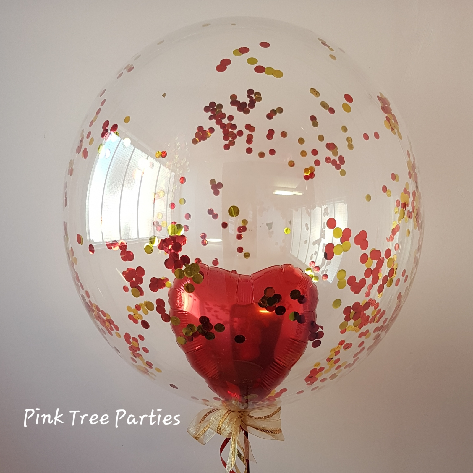 Confetti deco bubble balloon with foil heart